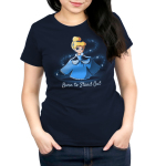 Born to Stand Out Women's t-shirt model officially licensed Disney t-shirt featuring Cinderella in her blue dress holding the sides of her dress out in each hand with a swirl of glitter around her