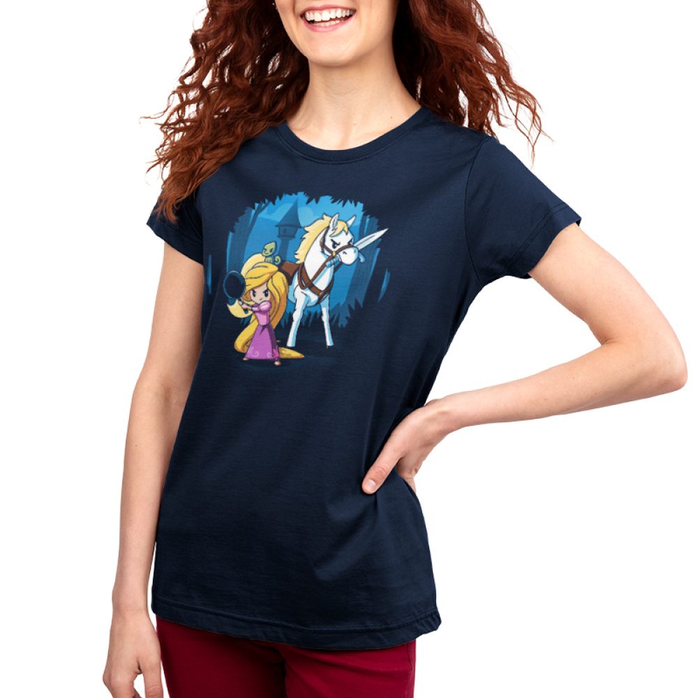 Rapunzel's Adventure Women's t-shirt model officially licensed navy t-shirt featuring Rapunzel in a pink dress holding up a frying pan with her horse next to her holding a sword in its mouth with her tower behind them