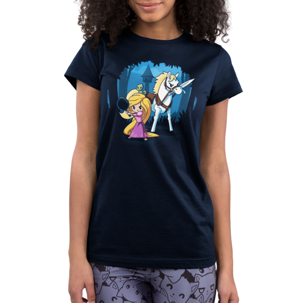 Rapunzel's Adventure Junior's t-shirt model officially licensed navy t-shirt featuring Rapunzel in a pink dress holding up a frying pan with her horse next to her holding a sword in its mouth with her tower behind them