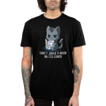 Don't Judge a Book by its Cover Men's t-shirt model TeeTurtle black t-shirt featuring a dark gray cat looking punk with a spiky collar on its neck and around its tail holding a book with rainbows and a white smiling cat on it