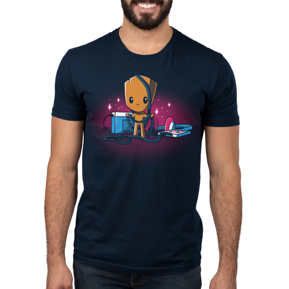 Groot's Mixtape Men's t-shirt model TeeTurtle navy t-shirt featuring Groot from Guardians of the Galaxy with a stereo and head set on the floor next to him with wires all wrapped around him