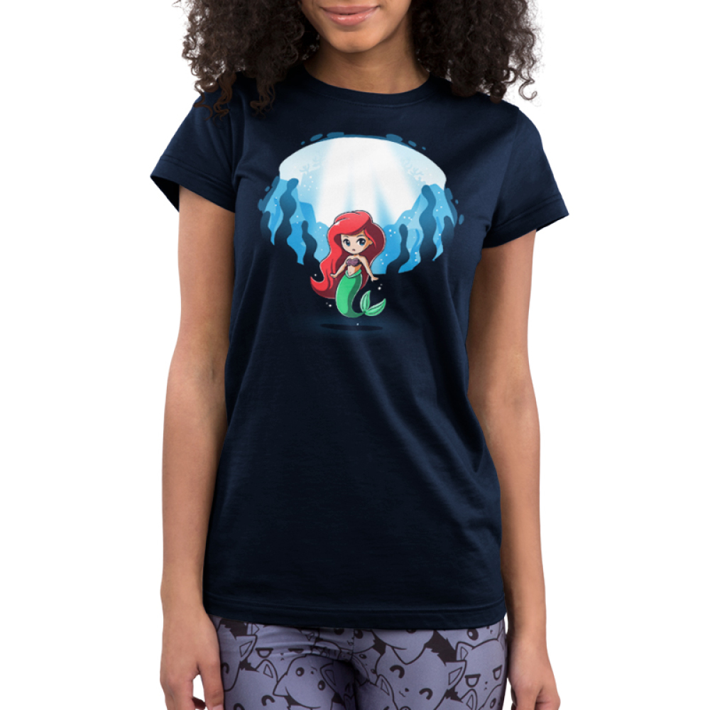 Ariel and Ursula (Glow) Junior's t-shirt model officially licensed navy t-shirt featuring Ariel under water with Ursula who appears behind her when the shirt glows in the dark
