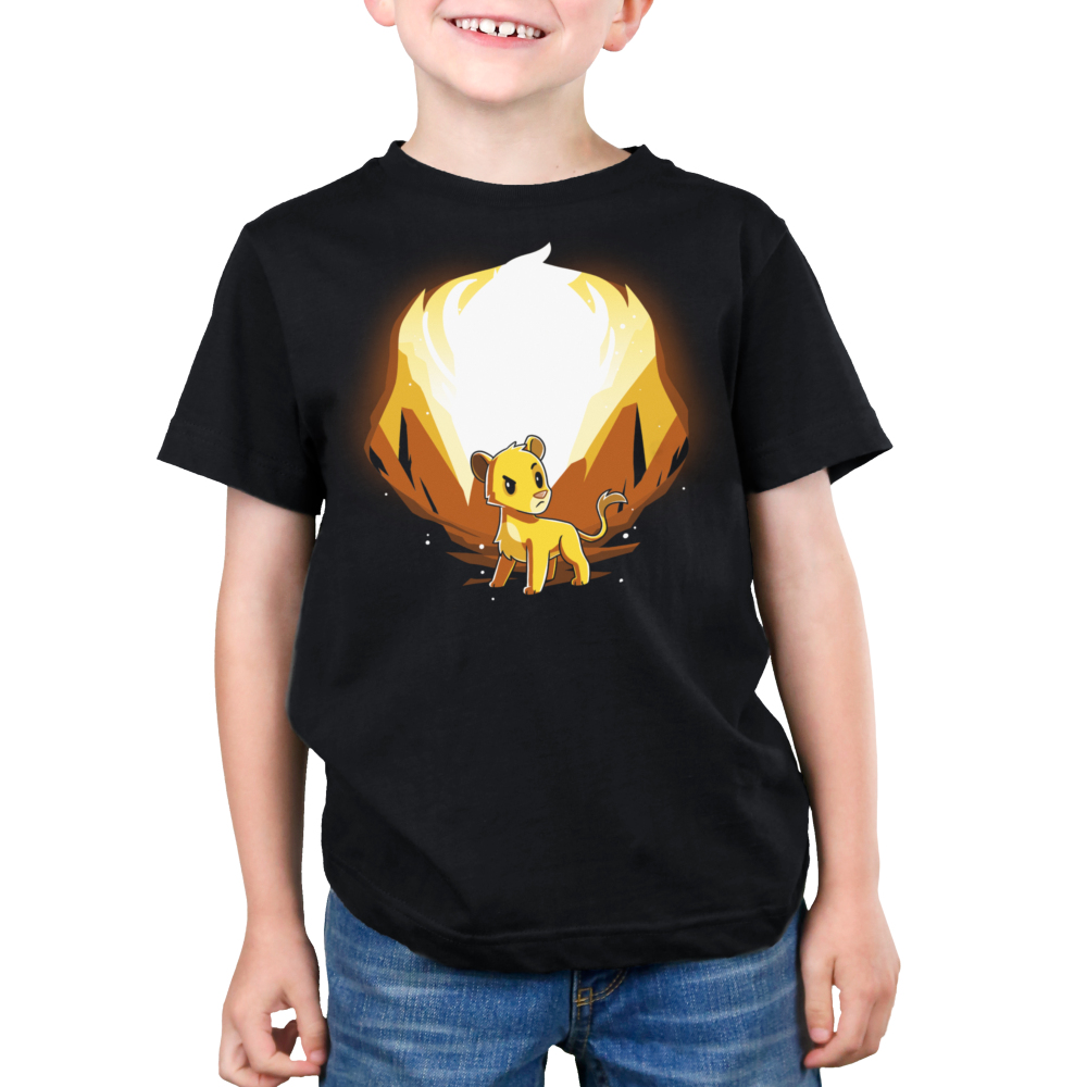 Simba and Scar (Glow) Kid's t-shirt model officially licensed black t-shirt featuring Simba with orange rocks behind him and Scar behind him when the shirt glows in the dark