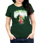 Aurora and Maleficent (Glow) Women's t-shirt model officially licensed forest green Disney t-shirt featuring Aurora in the forest with a castle behind her with Maleficent behind her when the shirt glows in the dark