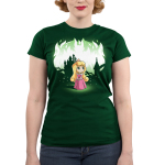 Aurora and Maleficent (Glow) Junior's t-shirt model officially licensed forest green Disney t-shirt featuring Aurora in the forest with a castle behind her with Maleficent behind her when the shirt glows in the dark