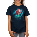 Part of Your World Kid's t-shirt model officially licensed navy Disney t-shirt featuring Ariel from The Little Mermaid under waters with her arms at her chest looking up with a beam of light around her and fish and bubble swirling behind her