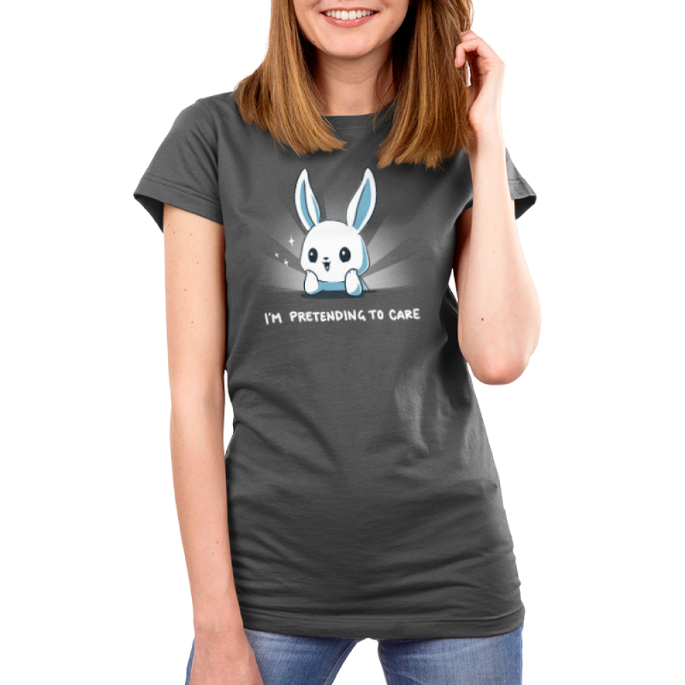 I'm Pretending to Care Women's t-shirt model TeeTurtle silver t-shirt featuring a bunny with its head resting on its hands looking bright eyed and cherry