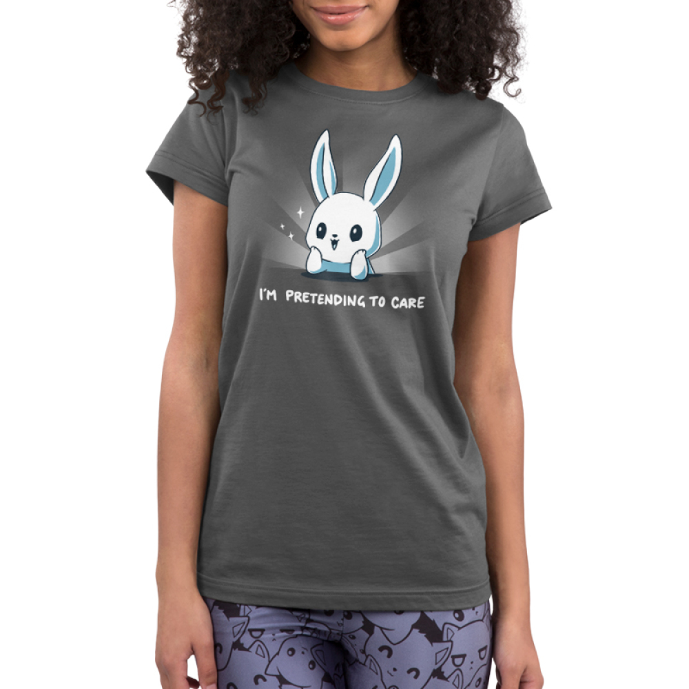 I'm Pretending to Care Junior's t-shirt model TeeTurtle silver t-shirt featuring a bunny with its head resting on its hands looking bright eyed and cherry