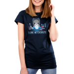 I Love Witchcrafts Women's t-shirt model TeeTurtle navy t-shirt featuring a cat starring down a swirling crystal call with its paws around it with candles and potions on the table