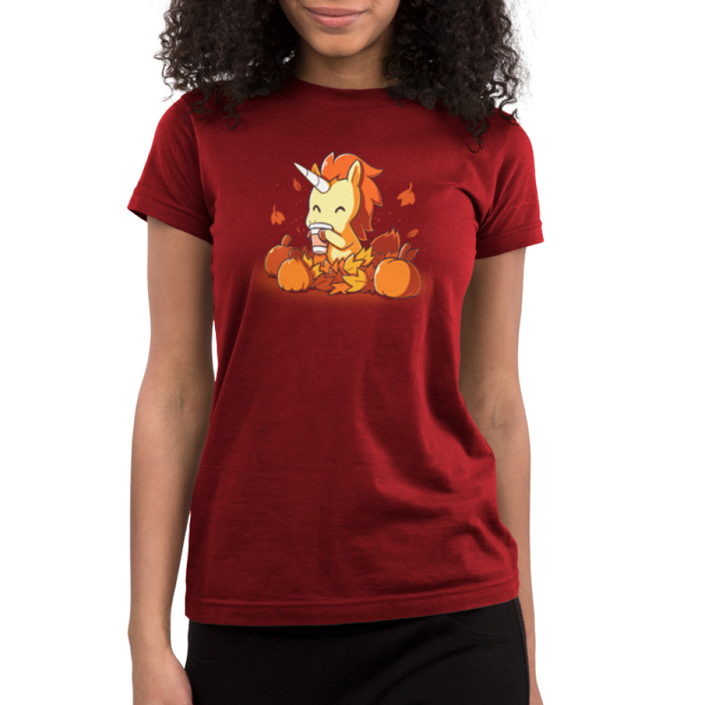 Pumpkin Spice Unicorn Junior's t-shirt model TeeTurtle garnet red t-shirt featuring an orange and yellow unicorn drinking a latte surrounded by pumpkins and falling leaves