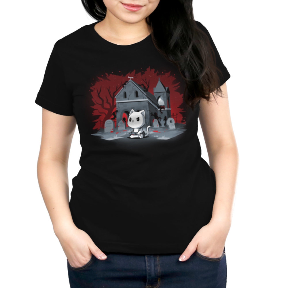 Horror Explorer Women's t-shirt model TeeTurtle black t-shirt featuring a white cat sitting on the ground with a video game controller in its paws with a spooky grave yard behind him with a red and black background with the outlines of twisty trees