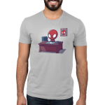 Desk Job Men's t-shirt model officially licensed silver Marvel t-shirt featuring Spider-Man sitting at a brown desk with papers and a phone on it with a picture of him on the wall behind him