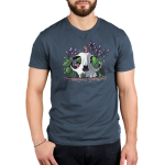 Skullduggery Men's t-shirt model TeeTurtle denim blue t-shirt featuring an animal skull with green leaves and purple flowers growing out of it with three smiley mice, one on top of the skull, one poking out of the eye of the skull, and one underneath the skull on the ground