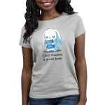 I Just Finished a Great Book Women's t-shirt model TeeTurtle silver t-shirt featuring a white bunny holding a blue book, and crying in joy since it just finished a great book.