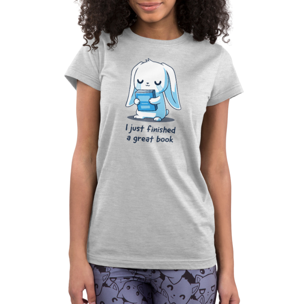 I Just Finished a Great Book Junior's t-shirt model TeeTurtle silver t-shirt featuring a white bunny holding a blue book, and crying in joy since it just finished a great book.