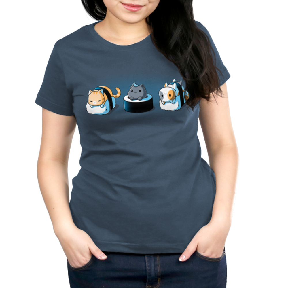 Sushi Cats Women's t-shirt model TeeTurtle denim blue t-shirt featuring an orange tabby cat, black cat with a blue feather on its head, and calico cat resting on their own pieces of sushi.