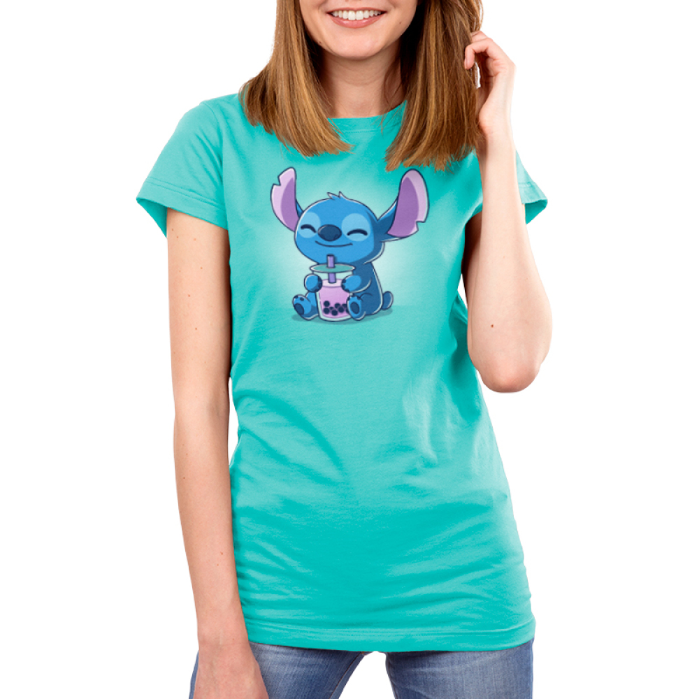 Boba Stitch Women's t-shirt model officially licensed Caribbean blue Disney t-shirt featuring Stitch sitting down with a big smile holding a purple boba drink