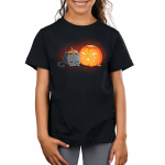 Pumpkin Carver Kid's t-shirt model TeeTurtle black t-shirt featuring a cute gray cat with its head down on its paws next to a pumpkin with a smiling cat face carved into it