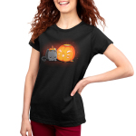 Pumpkin Carver Women's t-shirt model TeeTurtle black t-shirt featuring a cute gray cat with its head down on its paws next to a pumpkin with a smiling cat face carved into it