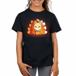 Candy Corn Kitsune Kid's t-shirt model TeeTurtle black t-shirt featuring a kitsune sitting down with a basket that looks like a pumpkin full of candy in front of him with its tails in the three colors of candy corn