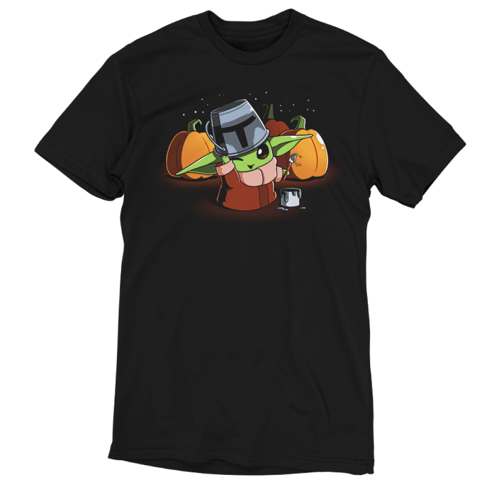 Mando Cosplay t-shirt officially licensed black t-shirt featuring The Child from The Mandalorian wearing a tin bucket thats been painting to look like the Mandalorian helmet with a buck of paint next to him and paint brush in his hand with three pumpkins behind him