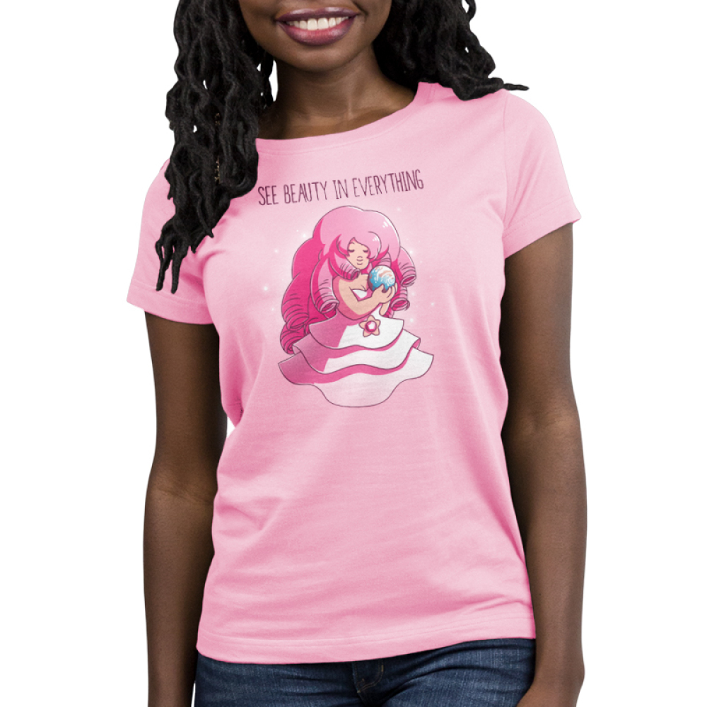 See Beauty in Everything Women's t-shirt model officially licensed pink Cartoon Network t-shirt featuring Rose Quartz from Steven Universe sitting in her pink dress holding a blue globe that looks like Earth