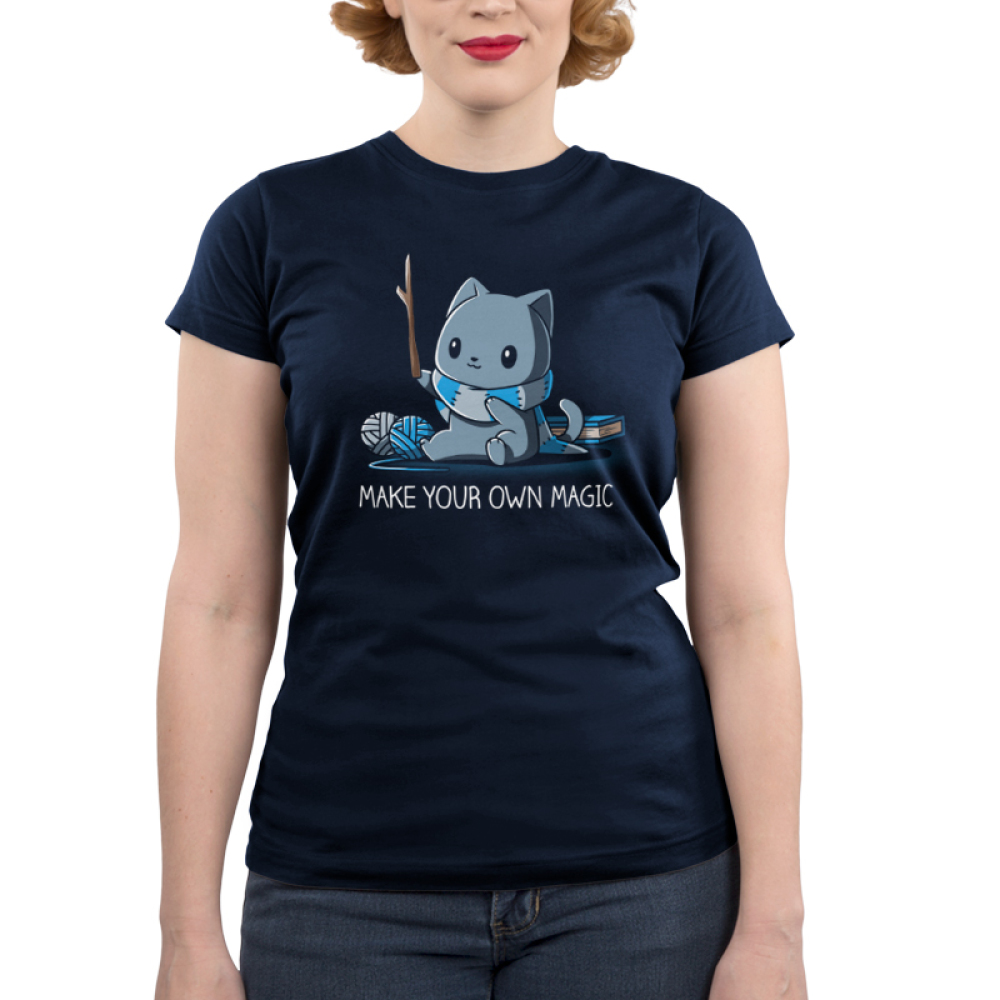 Make Your Own Magic Junior's t-shirt model TeeTurtle navy t-shirt featuring a gray cat in a blue and gray stripped shirt holding up a stick with balls of yarn and a book behind him