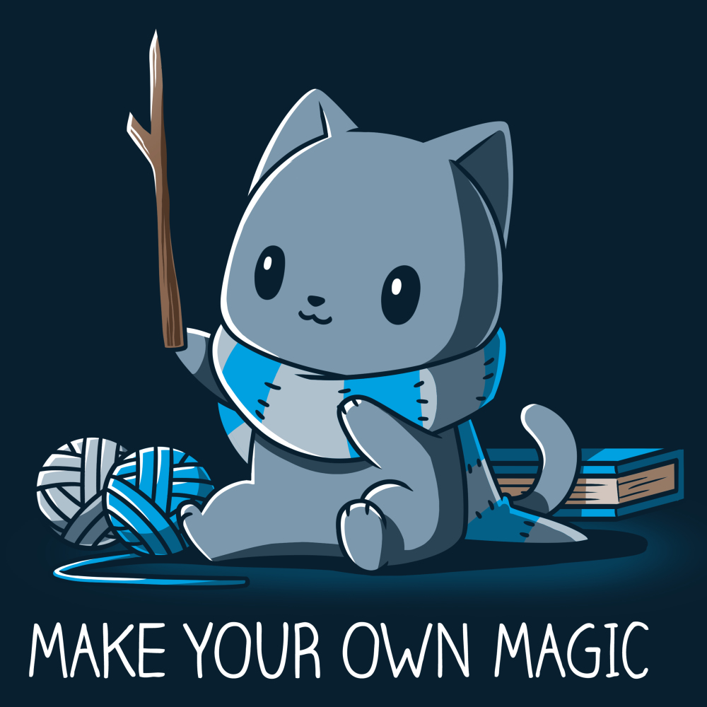 Make Your Own Magic t-shirt TeeTurtle navy t-shirt featuring a gray cat in a blue and gray stripped shirt holding up a stick with balls of yarn and a book behind him