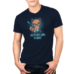 I Do My Best Work at Night Men's t-shirt model TeeTurtle navy t-shirt featuring a brown raccoon with his tongue sticking out while using a video game controller with a crescent moon and stars in the background.