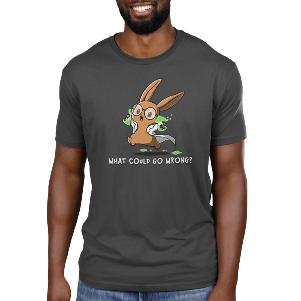 What Could Go Wrong Men's t-shirt model TeeTurtle charcoal t-shirt featuring a light brown bunny with big circle glasses wearing a white lab coat holding two science flasks with skulls on them filled with green bubbling liquid