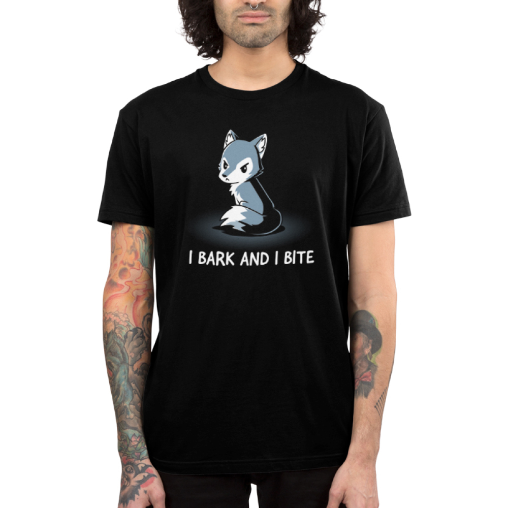 I Bark and Bite Men's t-shirt model TeeTurtle black t-shirt featuring an angry-looking gray and white wolf sitting up facing slightly to the lefthand side with its tail curled around itself.