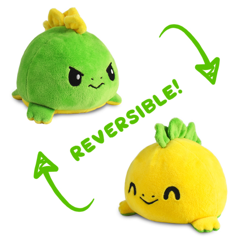 Reversible Stego plushie featuring a green angry looking dinosaur and flips into a yellow cheerful dinosaur