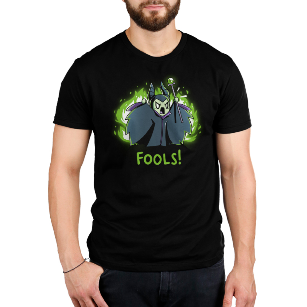 Fools! Men's t-shirt model officially licensed black Disney t-shirt featuring Maleficent looking angry and screaming with her arms up and staff in hand with green fire behind her