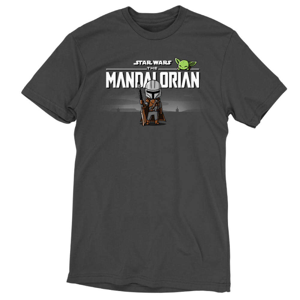 The Mandalorian t-shirt officially licensed charcoal Star Wars t-shirt featuring The Mandalorian logo up top with Mando standing underneath with his weapon in hand with The Child smirking above the logo
