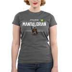 The Mandalorian Junior's t-shirt model officially licensed charcoal Star Wars t-shirt featuring The Mandalorian logo up top with Mando standing underneath with his weapon in hand with The Child smirking above the logo