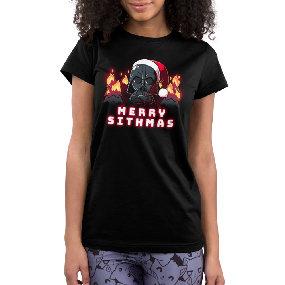 Merry Sithmas Junior's t-shirt model officially licensed black Star Wars t-shirt featuring Darth Vader with his arms crossed wearing a santa had with black christmas trees on fire behind him