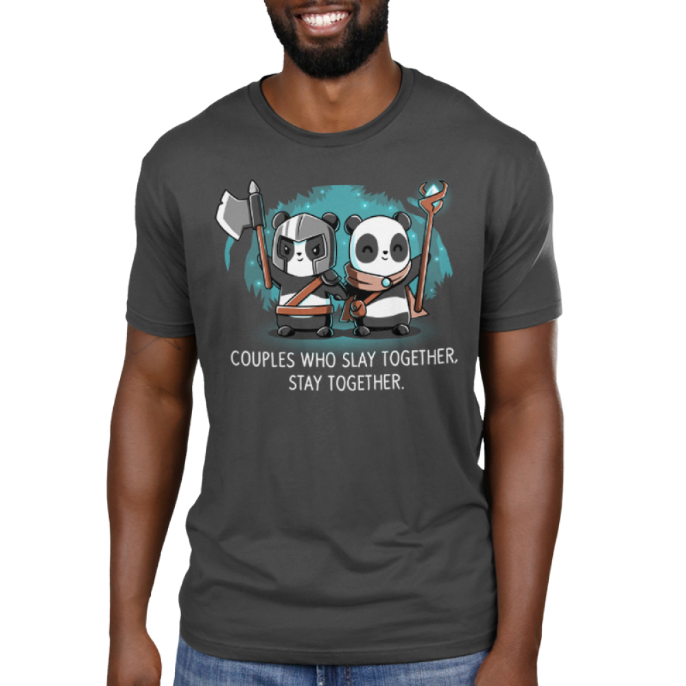 Couples Who Slay Together Stay Together Men's t-shirt model TeeTurtle charcoal t-shirt featuring one panda in a helmet holding an axe up and another in a cape smiling with a staff in her hand. They are holding hands in a forest with stars behind them