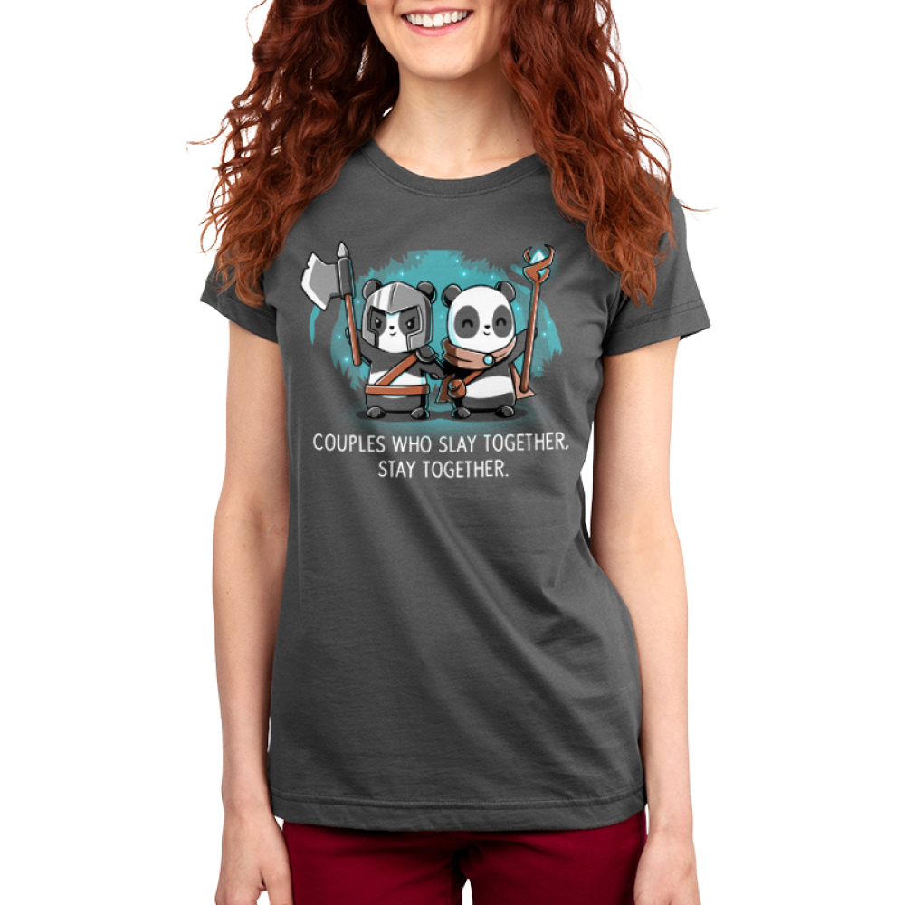Couples Who Slay Together Stay Together Women's t-shirt model TeeTurtle charcoal t-shirt featuring one panda in a helmet holding an axe up and another in a cape smiling with a staff in her hand. They are holding hands in a forest with stars behind them