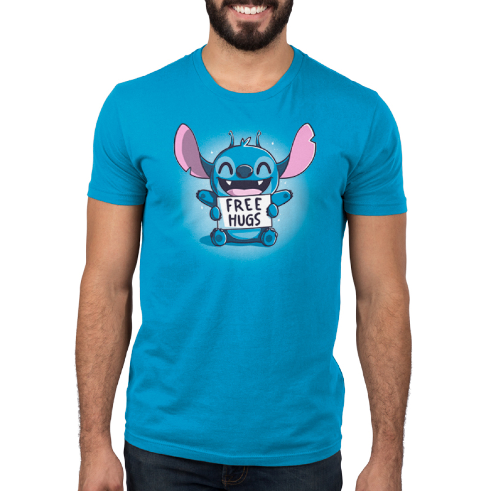 Free Hugs (Stitch) Men's t-shirt model TeeTurtle cobalt blue t-shirt featuring a grinning, sparkling Stitch from Lilo and Stitch sitting down with his upper arms held out and his lower arms holding a sign saying,