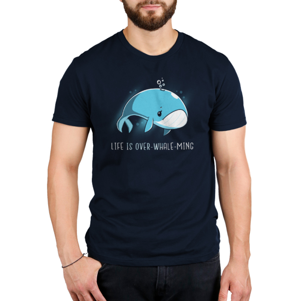 Life is Over-whale-ming Men's t-shirt model TeeTurtle navy t-shirt featuring a blue whale looking sad just floating under water
