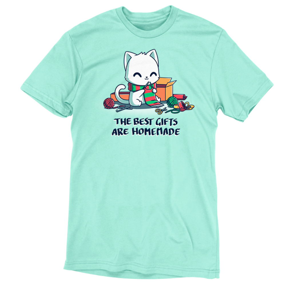 The Best Gifts are Homemade t-shirt TeeTurtle chill blue t-shirt featuring a happy sitting white cat wearing a green and red scarf while knitting a green and red scarf and is surrouded by boxes, yarn, scissors, knitting needles, and ribbons.