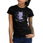 Bad Vibes Only Junior's t-shirt model TeeTurtle black t-shirt featuring a grumpy purple tabby cat sitting down with front paws crossed surrounded by skulls and clouds with lightning bolts.