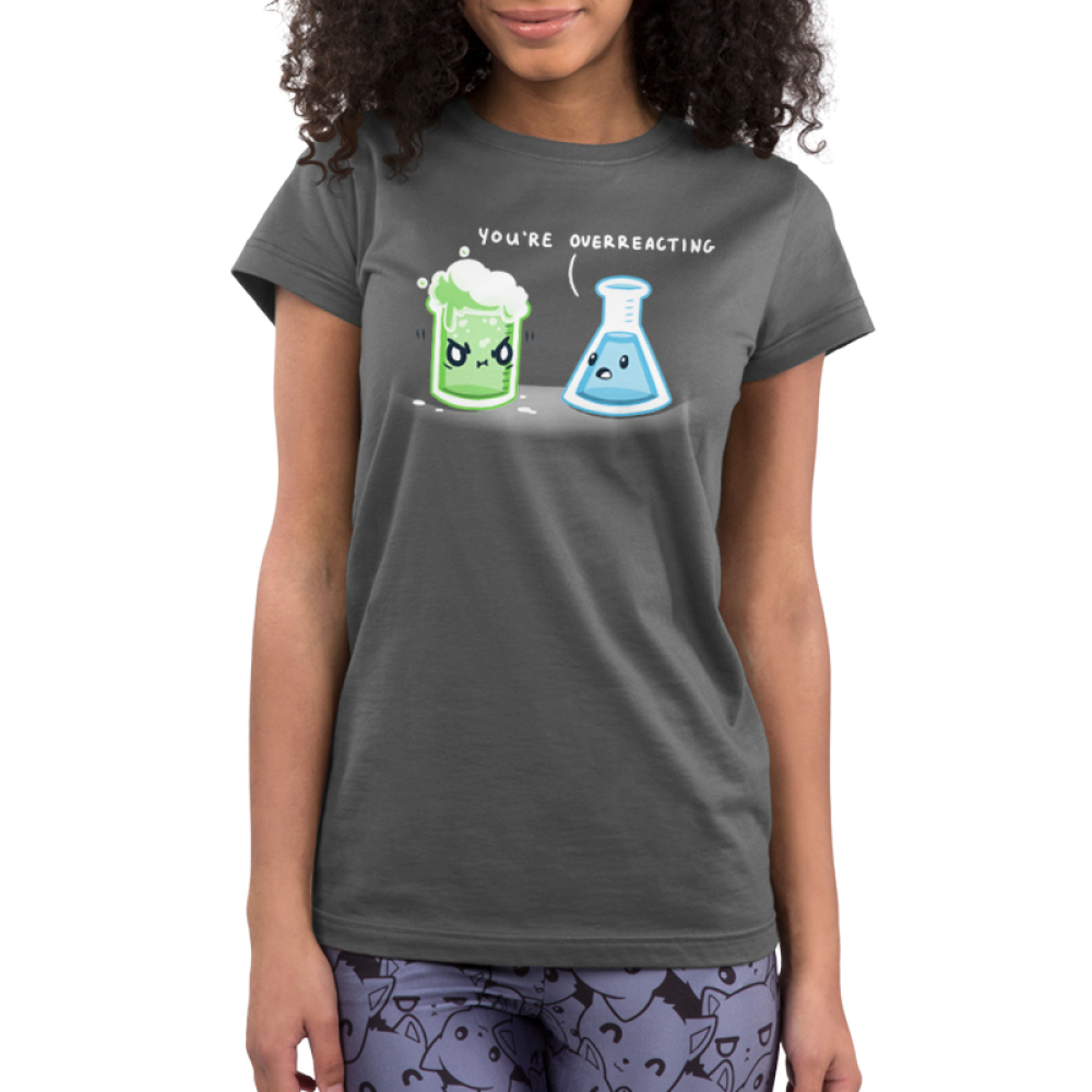 You're Overreacting Junior's t-shirt model TeeTurtle charcoal t-shirt featuring a science beaker with green bubbling liquid with an angry face and a worried looking flask with blue liquid