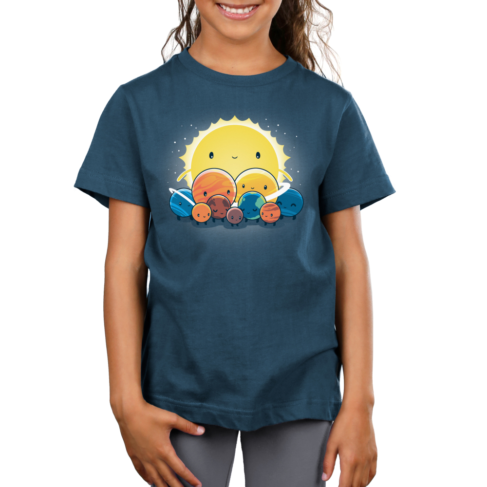 We Still Love You, Pluto Kid's t-shirt model TeeTurtle denim blue t-shirt featuring all the planets with smiley faces surround Pluto who looks sad with the big sun behind. them all