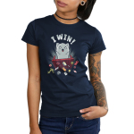 I Win! Junior's t-shirt model TeeTurtle navy t-shirt featuring a light gray cat with a starburst behind it flipping over a red table and scattering dice, playing cards and figurines all over the place.