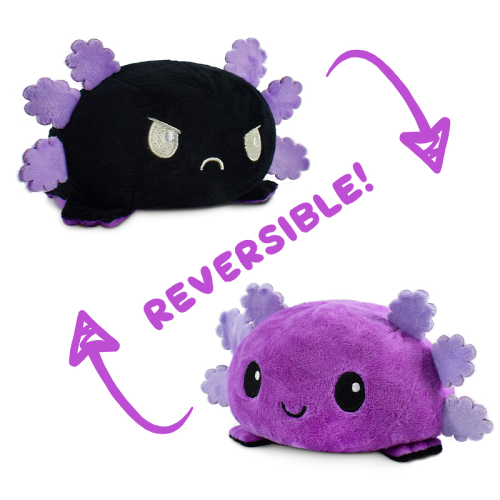 A happy purple reversible axolotl plushie with light purple fins flipping to a happy black reversible axolotl plushie with light purple fins.
