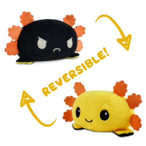 A happy yellow reversible axolotl plushie with orange fins flipping to a happy black reversible axolotl plushie with orange fins.