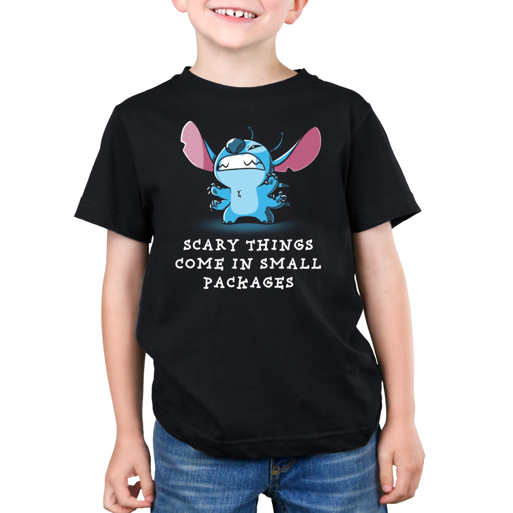 Scary Things Come in Small Packages Kid's t-shirt model officially licensed black Disney t-shirt featuring Stitch from Lilo and Stitch with all six limbs out and standing on his back legs making a cute growling expression with teeth barred.