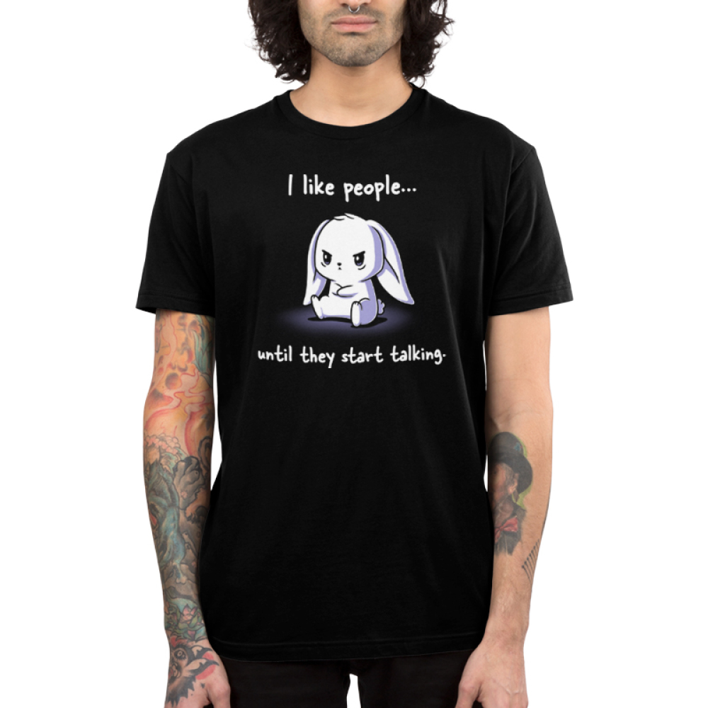 I Like People Until They Start Talking Men's t-shirt model TeeTurtle black t-shirt featuring a pouting white bunny sitting down with its arms crossed, and the fur on its head a bit rumpled up.