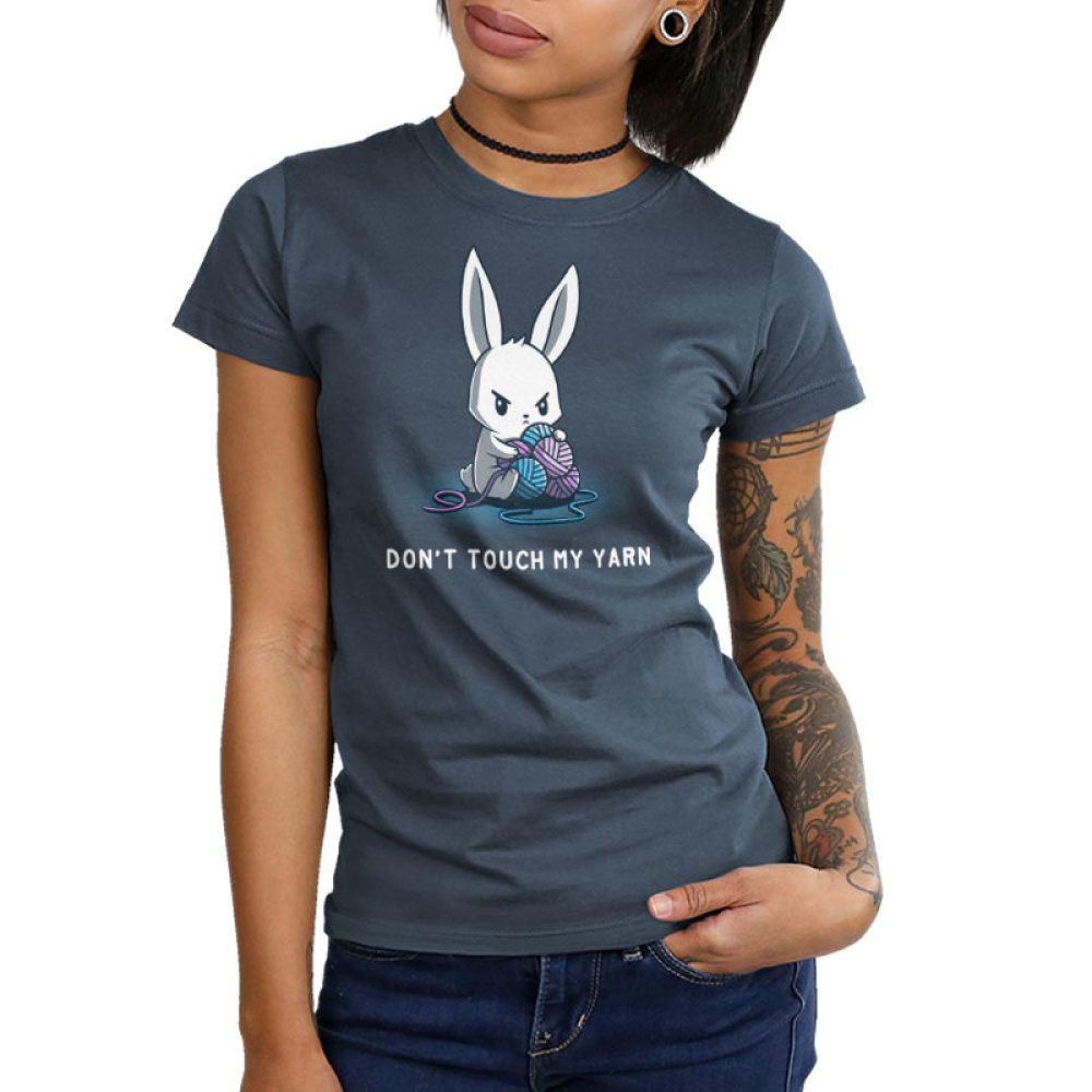 Don't Touch My Yarn Junior's t-shirt model TeeTurtle denim blue t-shirt featuring an angry white bunny sitting down and protectively holding onto a pile of blue and purple yarn.